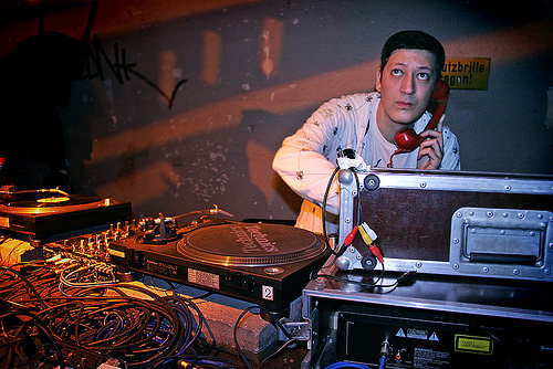 Mark Moore S'Express DJing with a red telephone headphone