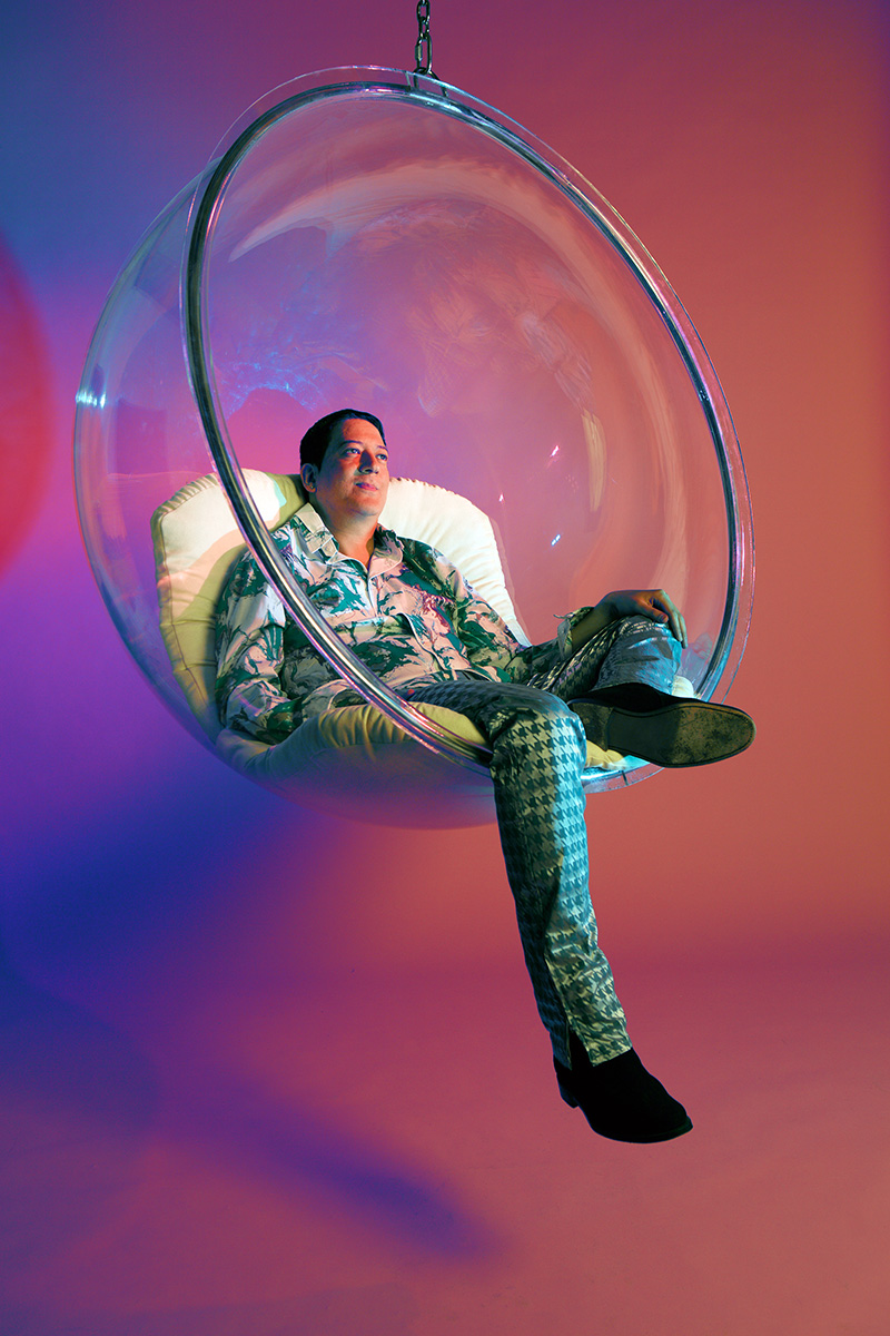 Mark Moore S'Express in a hanging bubble chair