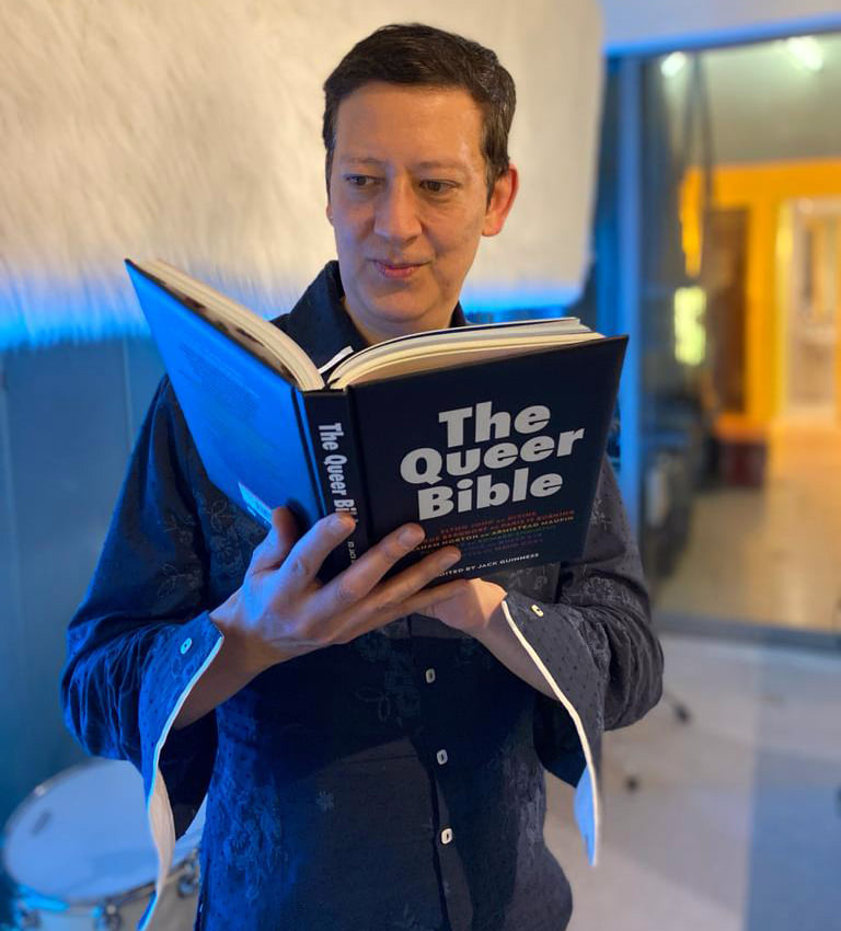 Mark Moore S'Express reading The Queer Bible book