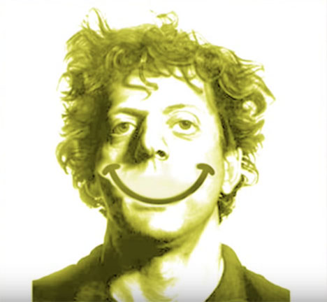 Philip Glass with a smiley face smile drawn on