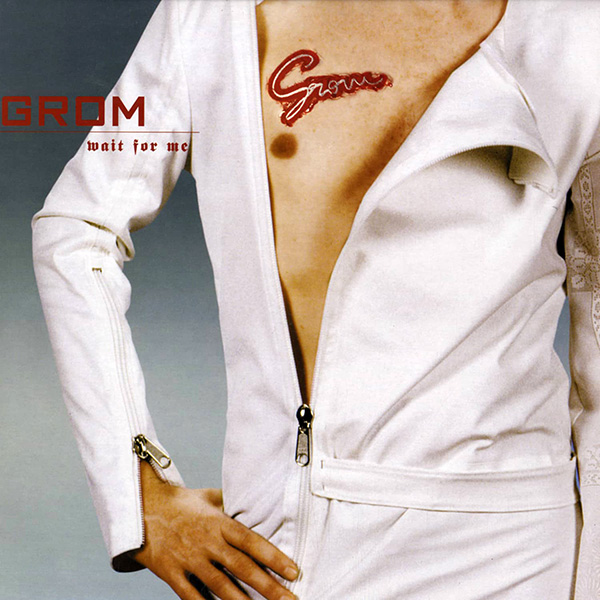 From Wait For Me record cover man in bare chest and white jump suit